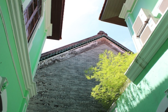 Cool green facades of the interior courtyard, Penang Peranakan Mansion. Lebuh Geraja (Church Street).