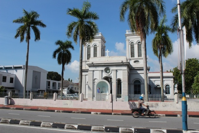 The Catholic Church of the Assumption (1860), and a speeding Penang motorcyclist. Jalan Sultan Ahmad Street.