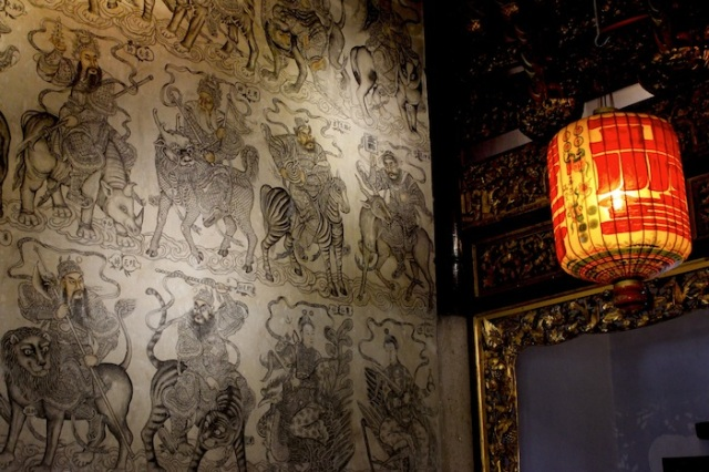 Interior of the Khoo Kongsi temple, every inch festooned with drawings and carvings of Chinese deities, heroes and symbols of good luck.