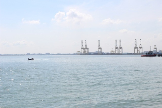 View from the Esplanade of the Port of Penang and a lone fishing boat.