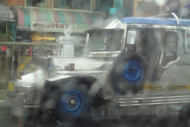 Apparition of a jeepney through the heavy rain.  View from my taxi along Roxas Boulevard.