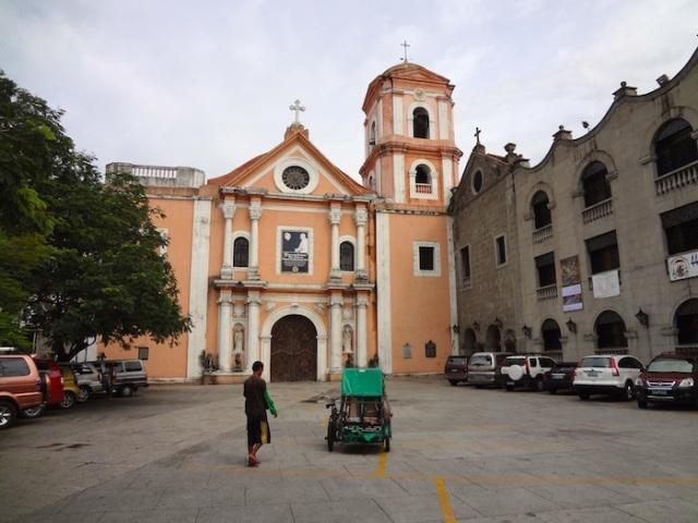 Entrance to the San Agustin Church, with a cyclo.
