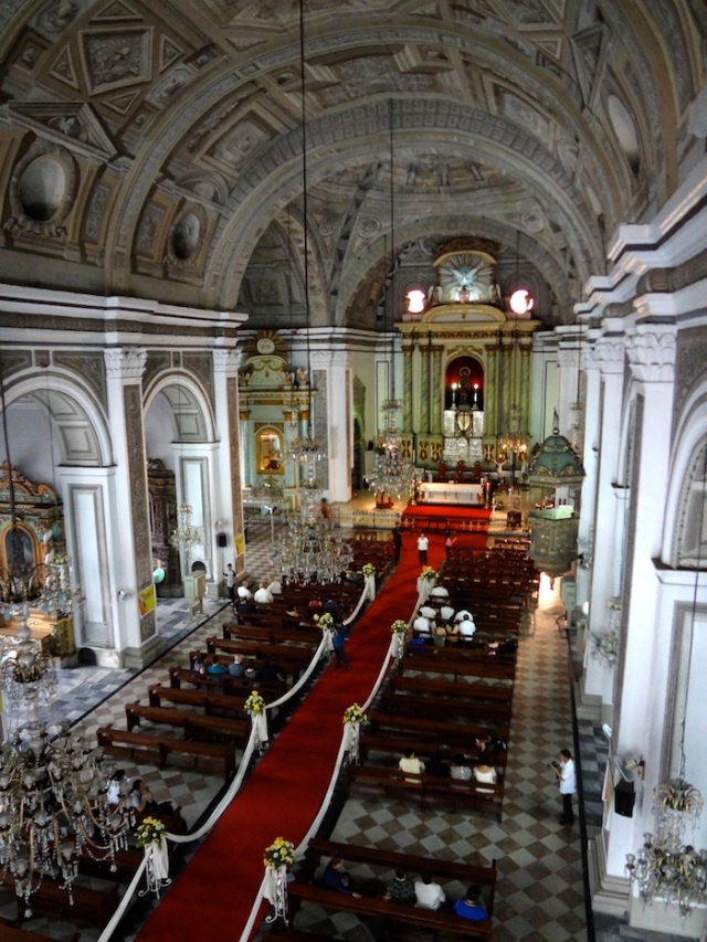 The journey ends at a wedding, about to take place within the San Agustin Church of Manila.