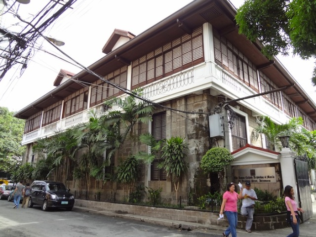 Traditional façade with the latticed windows in-filled with capiz shell to keep out the sun.