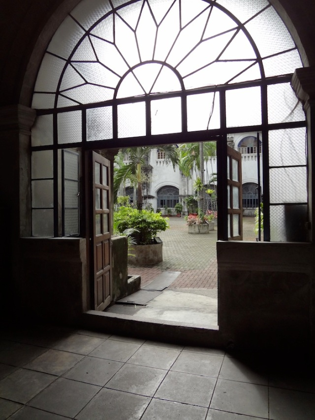 A door opens out onto the courtyard of the Church.