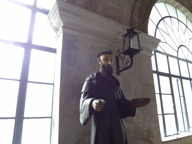Religious statuary along the cloisters of the Church.