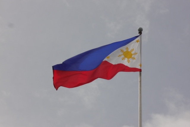 Storm brewing behind the Philippine Flag.