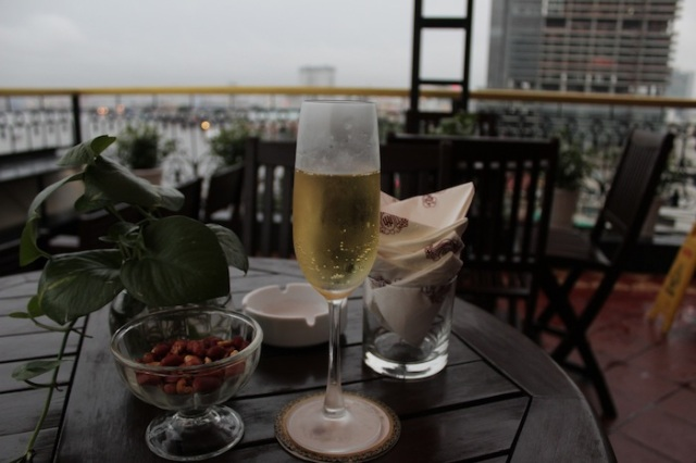 A glass of sparkling wine and a splendid view at the hotel's rooftop bar.