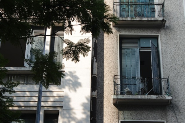 Beautiful shuttered windows of French era apartment buildings, on Dong Khoi Street.