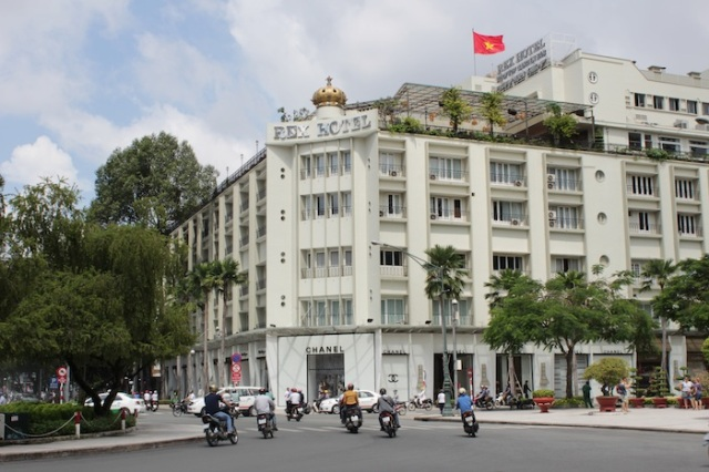The famous Rex Hotel (1966), with its roof-top bar. Not quite on Rue Catinat, but visible from it.  It was made famous by American G.I.s during the War as its conference room held a daily conference on the state of events.  While the façade remains, the interior is now plush, luxurious and contemporary.