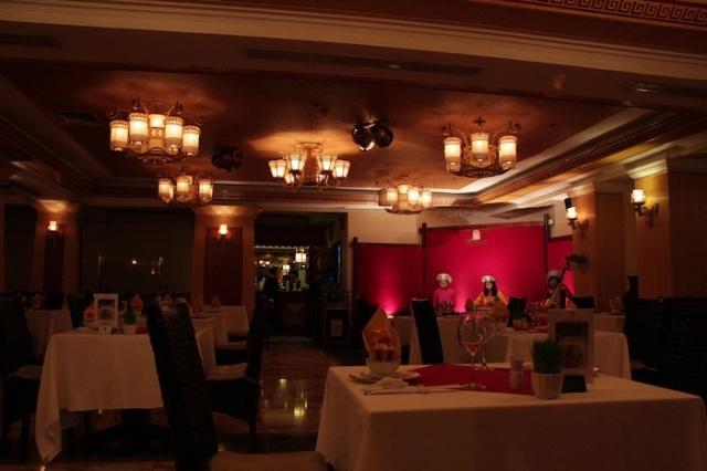 Traditional music ensemble in an empty Cyclo Café restaurant.
