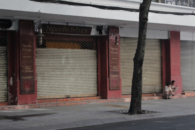 There has been store run by the Nguyen Brothers on this site since the '50s.  It was previously a cotton and silk store called Nguyen Chi Hoa.  Now its an antiques and novelties store.