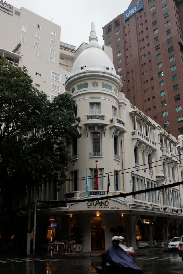 The Grand Hotel (1930), the third most famous hotel on the street, after the Continental and the Majestic.  It was once known as the Saigon Palace Hotel.  The art deco façade has been retained, but the building is now topped by a multi-storey tower.