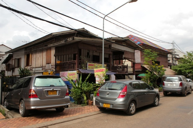 Traditional Lao wooden houses, very rare these days.  Thanon Nokeo Kumman.