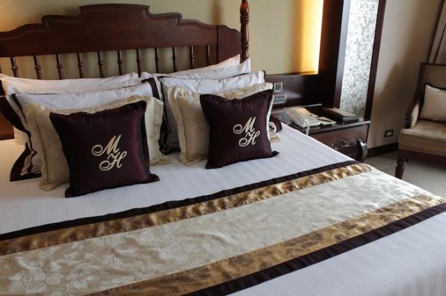 Room interior, extending the warm Filipino mahogany tones of the lobby.