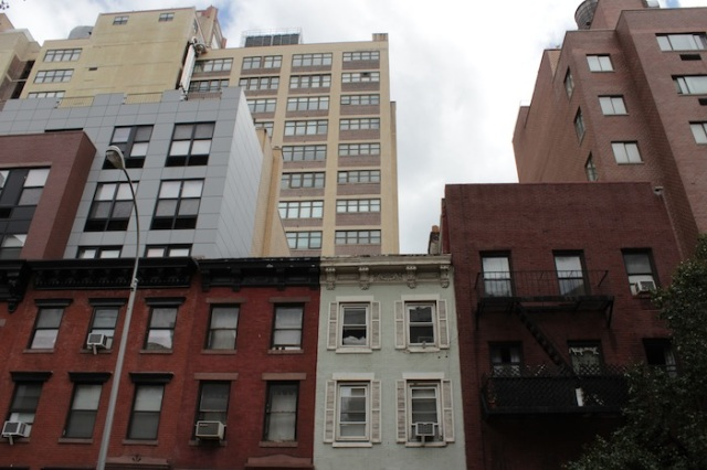 9 – Stark residential landscape consisting of a mix of tenements and high-rise apartments.