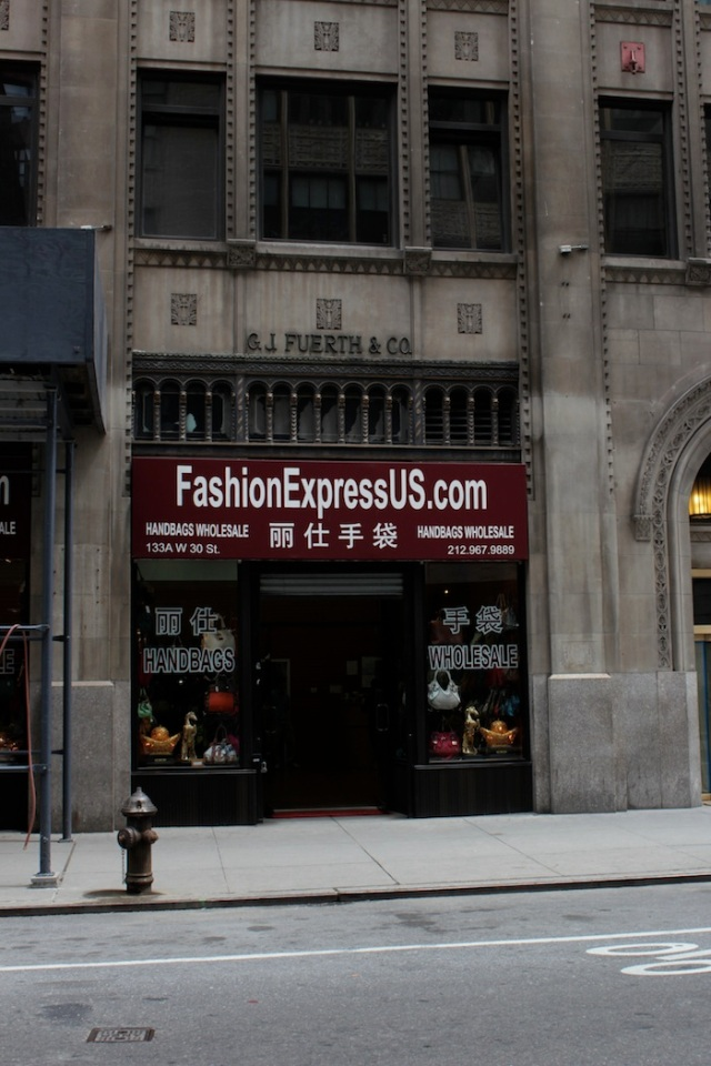 22 – No. 137 W 30th St: G. J. Fuerth & Co. building, now a Mainland Chinese wholesaler of cheap handbags and accessories.
