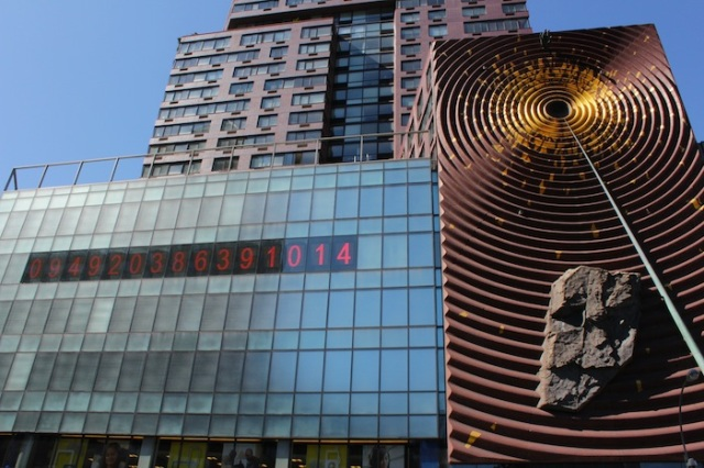 26 – Metronome, by Kristin Jones and Andrew Ginzel, the large public art installation on the façade of One Union Square South.  The digits to the left show the time using a 24 hour clock (if read from the left), and a reverse 24-hr clock, i.e. time remaining in the day, when read from the right.