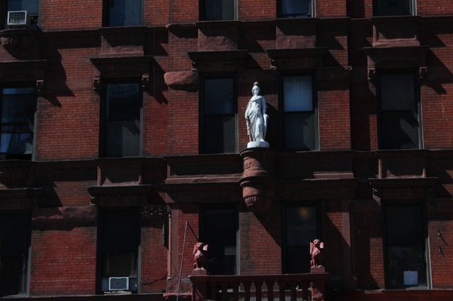 36 – A statue of Joan of Arc, presiding over a building named after her - the Jeanne d'Arc apartments (1888).