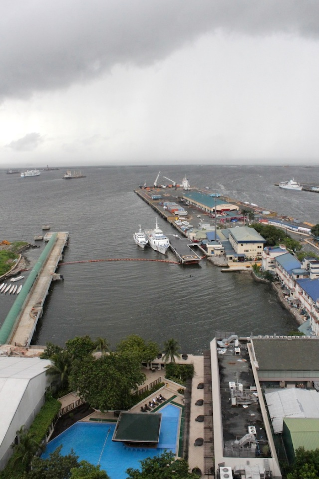 View from my window of Manila Bay, the Cruise Terminal, the Manila Hotel pool, and a huge storm brewing.