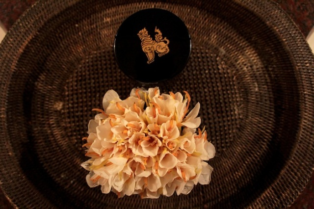 In my bathroom: a bouquet of deliciously scented local flowers, and a lacquer box with the hotel's logo.