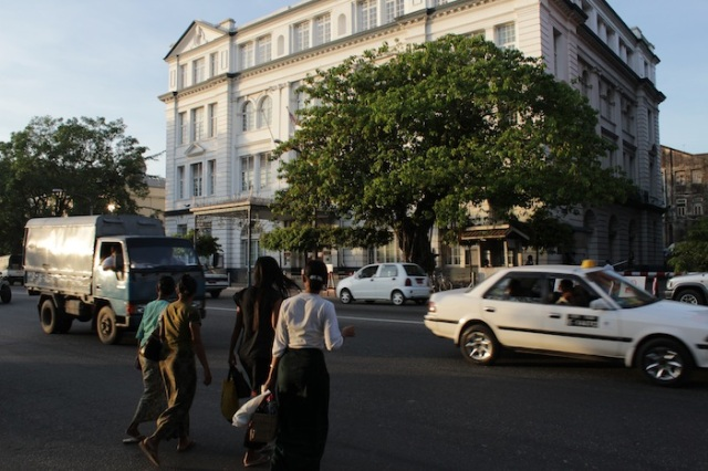 Burmese crossing Strand Road towards the British Embassy building.