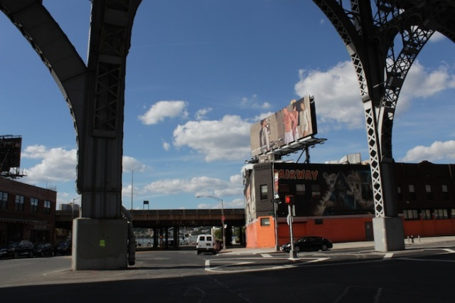 3 – Clouds gathering beneath Riverside Drive.  White man's advertising in a black man's world.
