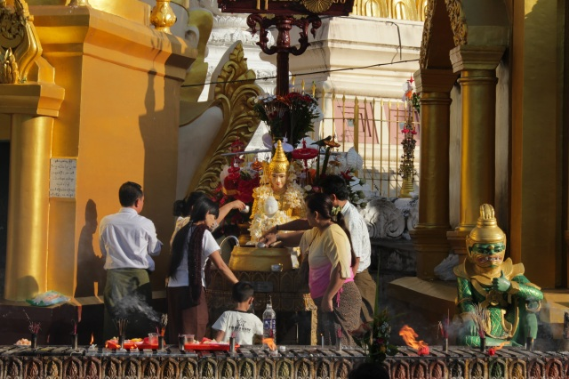 Washing the Buddha at the Shwedagon Pagoda complex.