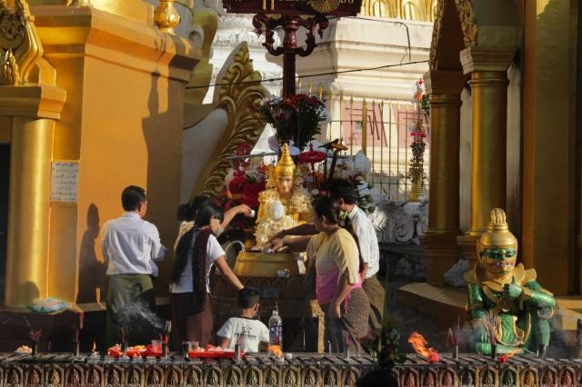 Washing the Buddha at the Shwedagon Pagoda complex.