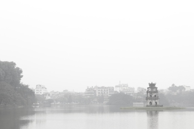 White out: Hoan Kiem Lake (Lake of the Returned Sword) shrouded in mist at dawn.