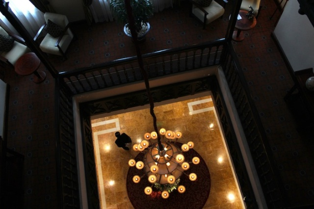 View down from the second floor to the hotel's lobby and iconic chandlier.