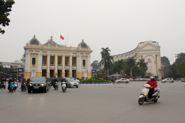 Hanoi Opera House to the left and the Hilton, to the right.