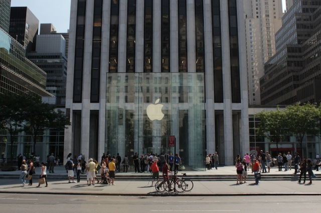 25 – Along the way, they stare curiously at Apple's transparent cube and its hordes of tourists.  Something they can never understand is Apple's enduring attraction for the masses.