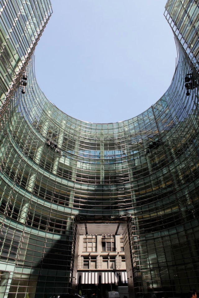 33 – Both have stood before the stunning courtyard at Bloomberg Tower, admiring the architecture.