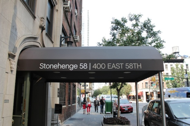 40 – A banner provides them with the inspiration for the shelter's name – Stonehenge 2058.