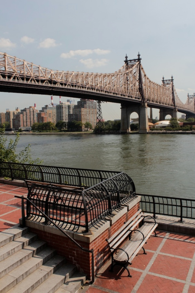 45 – At the edge of the water, they both sit and contemplate the view of Queensboro Bridge.  It is silent.  They have found peace and shelter, or so they think.