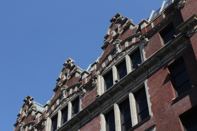 6 – He passes by the John Jay College of Criminal Justice.  And doubles back.  He looks up.  Gables!  He thinks, Gables!