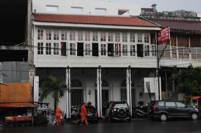 Refurbished old building along the Kali Besar, housing a budget hotel.