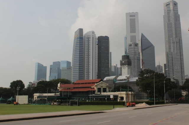 The Singapore Cricket Club, with the Padang in the foreground, and Boat Quay in the background
