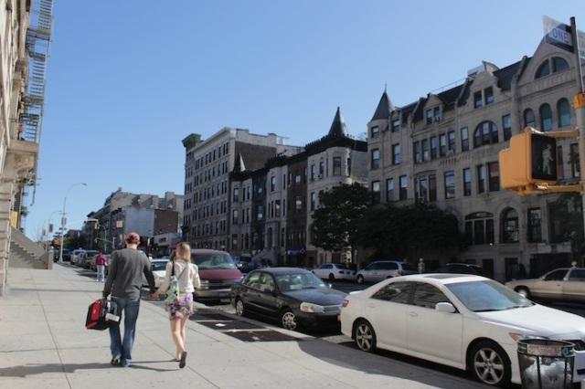 21 – White couple promenading down Edgecombe Ave.
