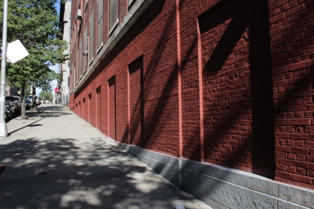 28 – Red brick walls disappearing.