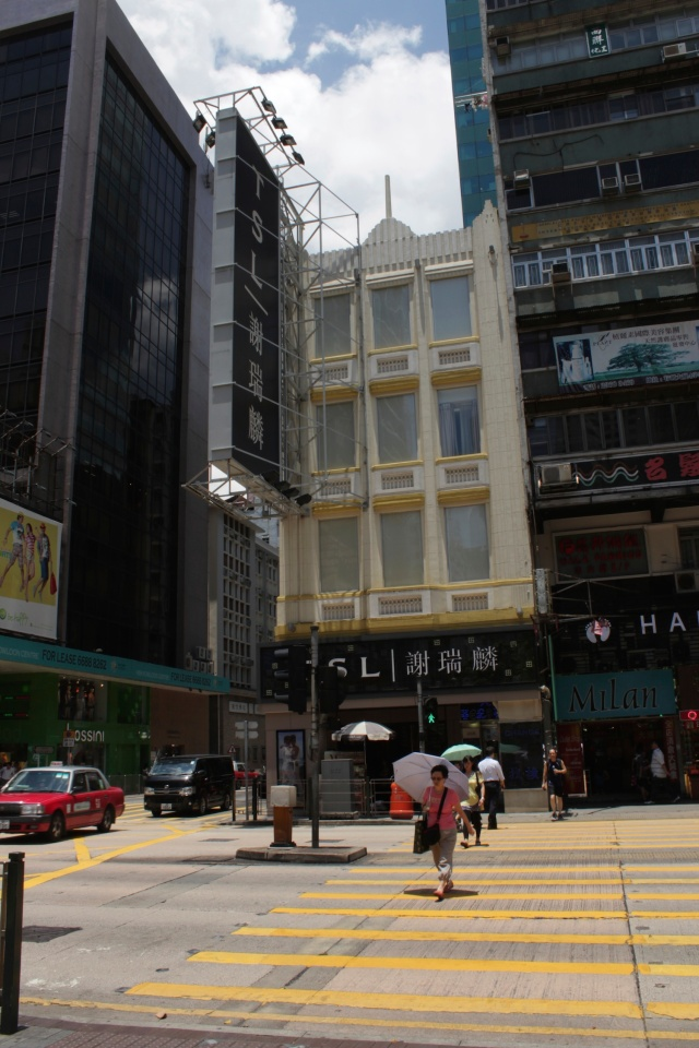 Turn of the century building wedged in amongst its contemporaries, Kowloon.