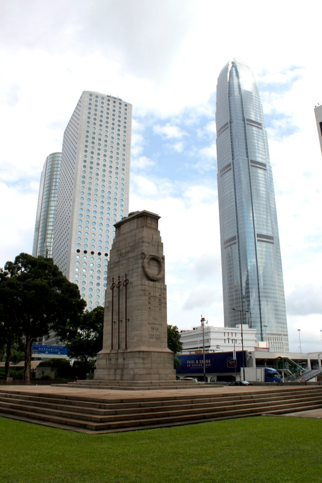 The Cenotaph (1923), commemorating the dead in both World Wars.  Behind it is Jardine House (1972) by Palmer & Turner, and 2 International Financial Centre (2003) by Cesar Pelli