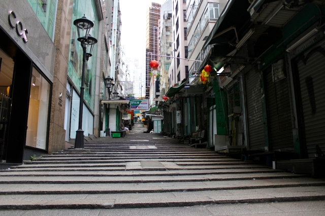 "Pottinger Street, known for its ""Stone slab stairway"" and once a major shopping street in the 1920s-30s."