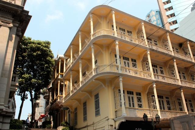 Elaborate commercial and residential facades along the Avenida de Almeida Ribeiro - the Champs-Elysees, Oxford Street or Orchard Road of Macau.