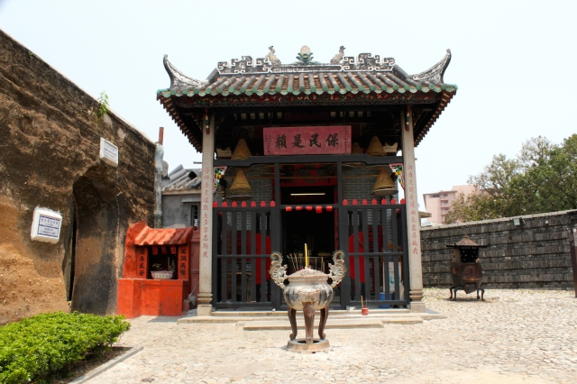 The Nezha Temple (1888) stands alongside the only remaining segment of Macau's original fortifying walls (from 1569).