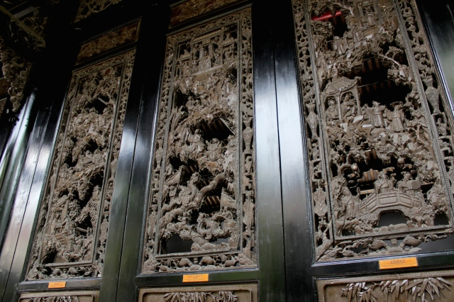 Ornate wooden panelling, reminiscent of similar panelling in Southeast Asian temples.