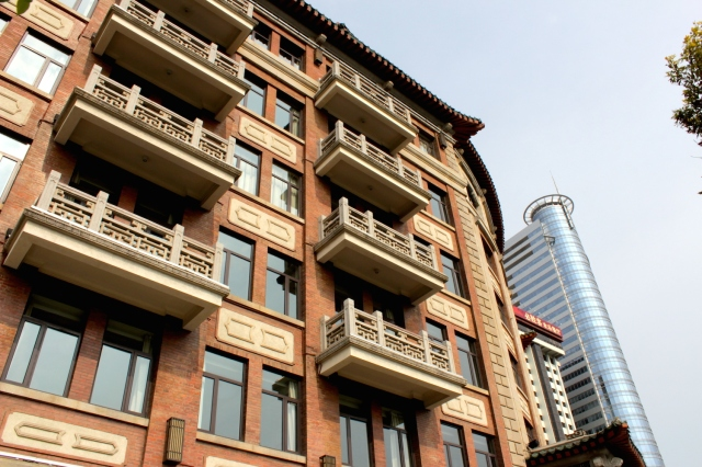 "Close-up of the side view of the Lujiang Hotel, showing the iconic balconies - typical of the ""Kah Kee"" style."