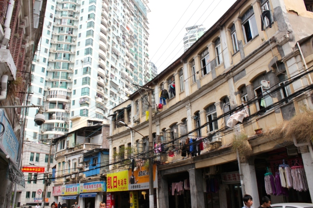 A row of crumbling shophouses set against a highrise condominium - showing just how the Old Town itself is changing rapidly.
