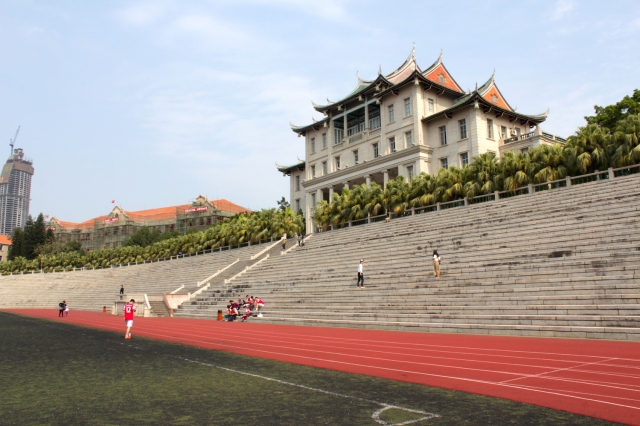 The Assembly Hall presides over the University's Olympic-size school-field and running track; which itself echoes the design of The Chinese High School's main building and schoolfield in Singapore.